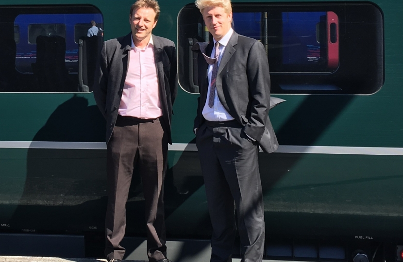 Transport Minister Jo Johnson and West Cornwall MP Derek Thomas at Penzance railway station.